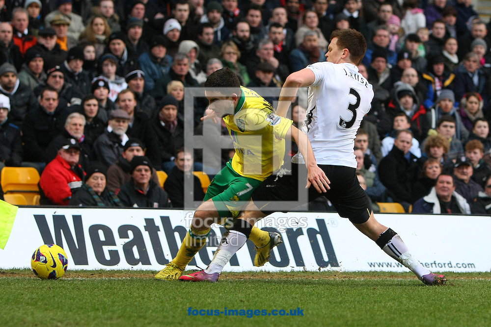 Picture by Paul Chesterton/Focus Images Ltd +44 7904 640267.09/02/2013.Robert Snodgrass of Norwich and John Arne Riise of Fulham in action during the Barclays Premier League match at Carrow Road, Norwich.