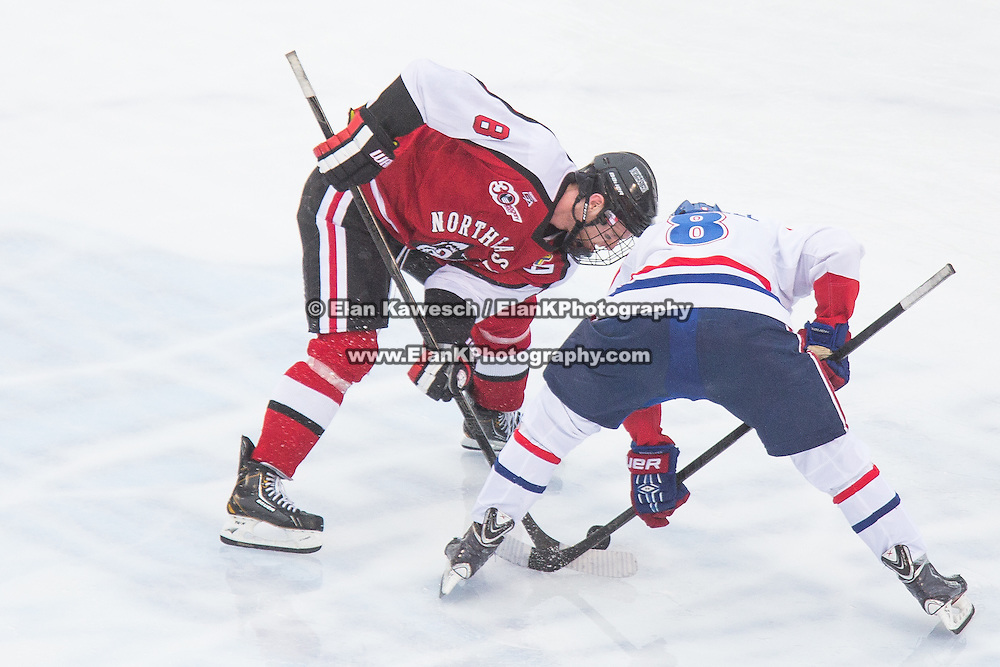 Adam Reid #8 of the Northeastern Huskies and Evan Campbell #8 of the UMass Lowell Riverhawks in action during the Frozen Fenway game between The Northeastern Huskies and The UMass Lowell Riverhawks at Fenway Park on January 11, 2014 in Boston, Massachusetts.