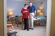 Leola, Pennsylvania - October 15, 2014: Joanne Griffiths uses her cane to flirt with her husband Joe Griffiths while posing for a photograph in front of her therapy bed in what used to be their downstairs living room. Joanne Griffiths, 64, suffered a stroke two years ago, and her husband Joseph Griffiths, 65, became her primary care-giver. She can now walk, with the assistance of her cane, and talk at a normal volume. The doctors, nurses, and physical therapists who helped Joanne get better, also advised Joe how to best care for his wife of 41 years at home. Next year AARP will help push for the passage of the Caregiver Advise, Record, Enable (CARE) Act. The CARE Act would require hospitals and rehab centers to identify caregivers and give them in-person instructions for medical tasks such as injections, wound care and transfers so they can confidently perform them at home.<br /> CREDIT: Matt Roth
