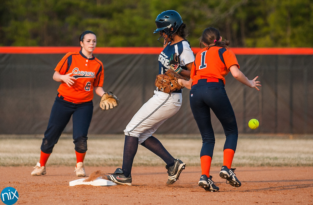 Hickory Ridge's Kaylon Perkins makes it to second base as Carson's Kaycee Kennedy drops the ball while trying to tag her out Monday night in China Grove. Carson won the game 5-1.