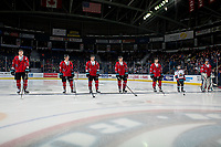 KELOWNA, CANADA - MARCH 9:  Kaedan Korczak #6, Michael Farren #16, Kyle Topping #24, Ted Brennan #10, Schael Higson #21 and Roman Basran #30 of the Kelowna Rockets stand on the blue line as the starting line up against the Kamloops Blazers on March 9, 2019 at Prospera Place in Kelowna, British Columbia, Canada.  (Photo by Marissa Baecker/Shoot the Breeze)