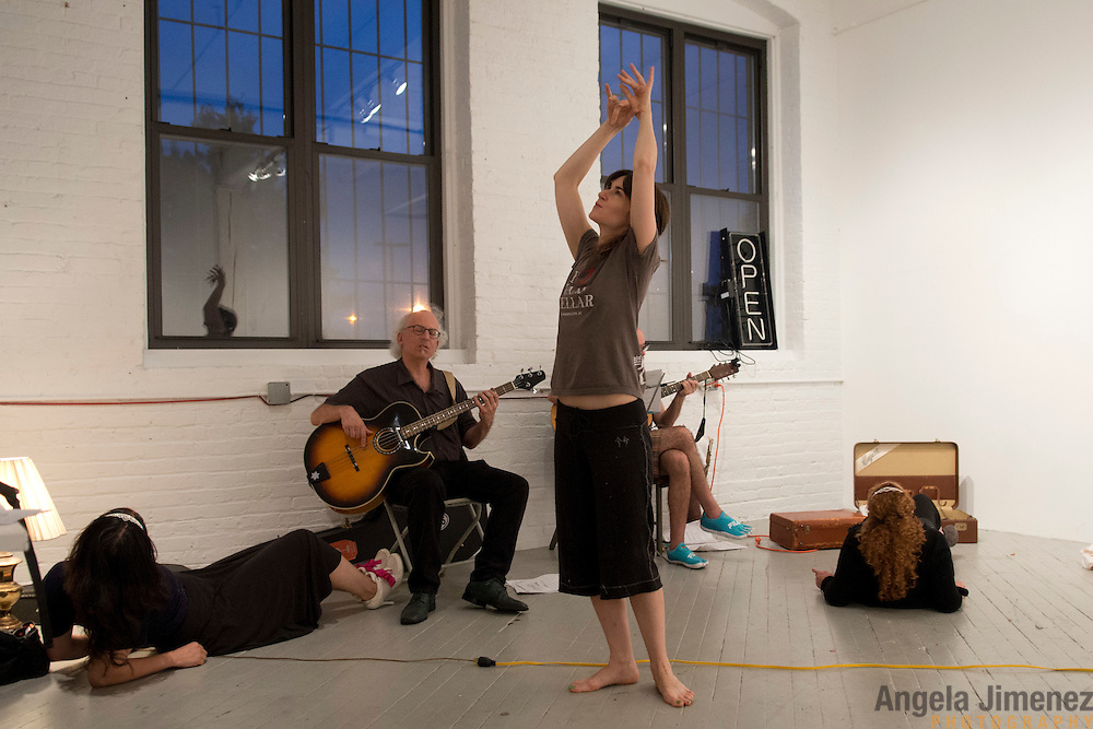 "20120801AJ  ..Writer/performer Cassandra Chopourian, cetner, rehearses ""Shelly's Spherical Journey"" with the Jersey City-based theater company Van Reipen, which she runs in collaboration with writer/composer Gary Heidt, at the Old American Can Factory in Brooklyn, New York on August 1, 2012. The show opens at the New York Fringe Festival on August 11, 2012. ..Other rehearsal participants are, from left: .Performer Christina Gulick.Bassist Steve Wishnia.Guitarist Richard Gross.Performer Cari Bell...photo by Angela Jimenez/ for The Star-Ledger ...."