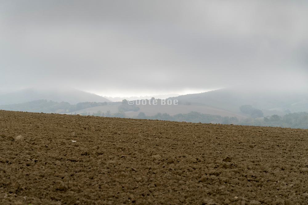 morning fog in rural agricultural landscape during autumn season