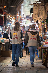29 February 2020, Jerusalem: Ecumenical Accompaniers Kristin (left) and Charlotte (right) walk through a market street in the Muslim Quarter of the Jerusalem Old City.