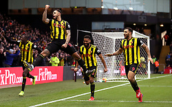Watford's Andre Gray (second left) celebrates scoring his side's first goal of the game with team mates during the Premier League match at Vicarage Road, Watford.