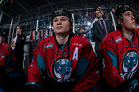 KELOWNA, CANADA - MARCH 16:  Kaedan Korczak #6 of the Kelowna Rockets sits on the bench at the start of the game against the Vancouver Giants on March 16, 2019 at Prospera Place in Kelowna, British Columbia, Canada.  (Photo by Marissa Baecker/Shoot the Breeze)
