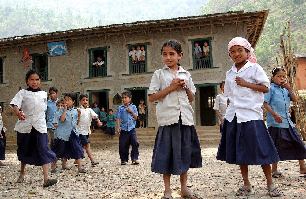 "RUKUM DISTRICT, NEPAL, APRIL 20, 2004:  Nepalese children stan in a government school yard in Rukum  district April 20, 2004. Ill-equipped security forces in politically unstable Nepal are unable to control  Maoist rebels, who continue to abduct thousands of villagers for forcible indoctrination and military training.  The Maoists mainly target students, teachers and youths. The victims are usually released after a few days of indoctrination, unless they actively resist the ""training attempts,"" in which case the rebels torture or sometimes kill them. Maoist insurgents have capture most of the Western part of Nepal in their attempt to make it a Communist State. Analysts and diplomats estimate there about 15,000-20,000 hard-core Maoist fighters, including many women, backed by 50,000 ""militia"".  In their remote strongholds, they collect taxes and have set up civil administrations, and people's courts. They also raise money by taxing villagers and foreign trekkers.  They are tough in Nepal's rugged terrain, full of thick forests and deep ravines and the 150,000 government soldiers are not enough to combat this growing movement that models itself after the Shining Path of Peru. (Ami Vitale/Getty Images)"