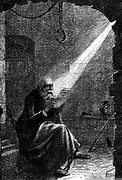 John Huss or Hus (c1369-1415)  Bohemian religious reformer and theologian. Burned at stake at Constance as a heretic.  Huss in prison.  Illustration by Charles Joseph Staniland (1838-1916) English marine painter and illustrator, for 'Sunday at Home' (London, 1866).