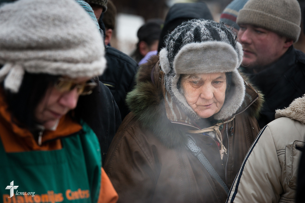 A woman waits for soup at a Diaconia Center of The Evangelical Lutheran Church of Latvia soup kitchen site on Thursday, Feb. 5, 2015, in Riga, Latvia. LCMS Communications/Erik M. Lunsford