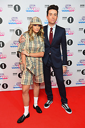 Rita Ora and Nick Grimshaw attending the BBC Radio 1 Teen Wards, at Wembley Arena, London. Picture date: Sunday October 22nd, 2017. Photo credit should read: Matt Crossick/ EMPICS Entertainment.