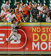 June 25, 2012; Houston, TX, USA; San Diego Padres right fielder Chris Denorfia (13) leaps for a home run ball against the Houston Astros during the first inning at Minute Maid Park. Mandatory Credit: Thomas Campbell-US PRESSWIRE