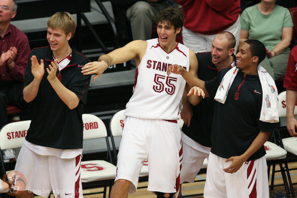 January 31, 2007; Stanford, CA, USA; Stanford Cardinal forward Will Paul (34, left), center Peter Prowitt (55), guard Chris Bobel (2, second from right), and guard Carlton Weatherby (3, far right) celebrate during the game against the Gonzaga Bulldogs at Maples Pavilion. The Bulldogs defeated the Cardinal 90-86.