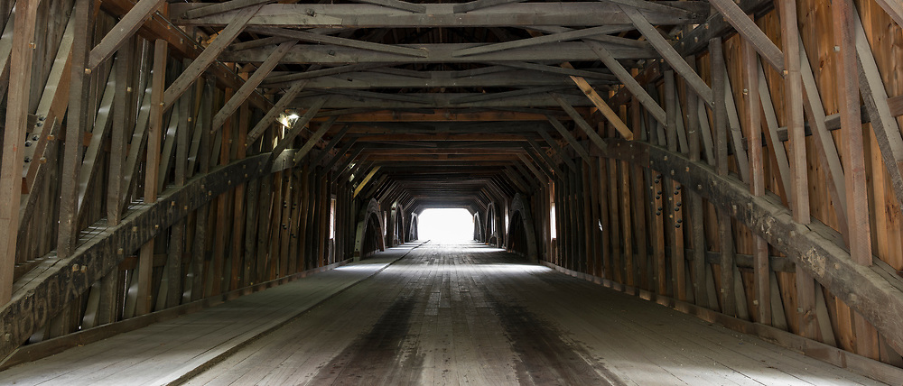 Trusses and beams in geometric shapes of covered bridge in New Hampshire, USA
