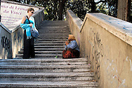 Rome   August  21 2008.<br /> A Roma woman  asks for alms on stairway of Pincio