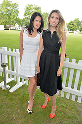 Left to right, AMY MOLYNEAUX and AMY HOLDEN-SMITH at the Flannels for Heroes Cricket tournament in association with Dockers in aid of the charities Walking With The Wounded, On Course Foundation and Combat Stress held at Burton Court, London on 20th June 2014.