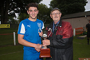 Grenville Dawson secretary of the Dundee Schools Football Association presents the Senior Johnston Trophy to St John's captain Keiran Conway - Grove (light blue v St John's (blue) Senior Johnston Trophy Final at Whitton Park, Dundee, Photo: David Young<br /> <br />  - &copy; David Young - www.davidyoungphoto.co.uk - email: davidyoungphoto@gmail.com