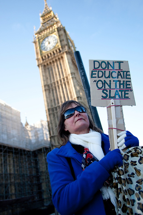 Student fees protester demonstrating outside Houses of Parliament