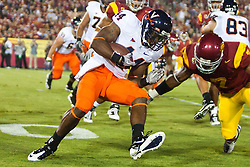 September 11, 2010; Los Angeles, CA, USA;  Virginia Cavaliers running back Raynard Horne (44) is tackled by Southern California Trojans safety T.J. McDonald (7) during the second quarter at the Los Angeles Memorial Coliseum.