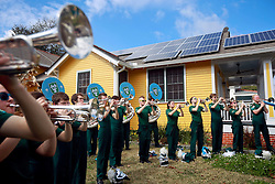 02 March 2014. New Orleans, Louisiana.<br /> Mardi Gras. The Tulane Band warms up before the start of the Krewe of Thoth parade in Uptown New Orleans.<br /> Photo; Charlie Varley/varleypix.com