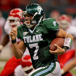 Oct 17, 2009; New Orleans, LA, USA; Tulane Green Wave quarterback Joe Kemp (7) runs with the ball in the second half against the Houston Cougars at the Louisiana Superdome. Houston defeated Tulane 44-16. Mandatory Credit: Derick E. Hingle-US PRESSWIRE