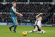 Wigan Athletic midfielder Max Power (6) and Derby County defender Alex Pearce (16) during the EFL Sky Bet Championship match between Derby County and Wigan Athletic at the iPro Stadium, Derby, England on 31 December 2016. Photo by Richard Holmes.
