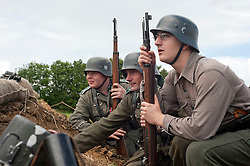 Reenactors portray panzer grenadiers from the elite German Großdeutschland Division during he Spam 1940s Wartime Weekend Heckmondwike day one.<br /> 9th July 2011