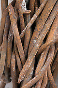 close up stack of old rusty nails