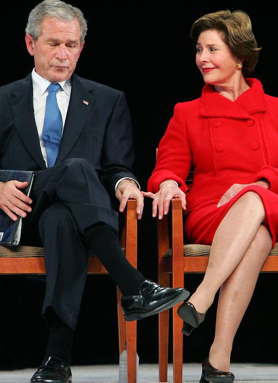 ORG XMIT: TXDAM120 Former first lady Laura Bush and former President George W. Bush listen as former Vice President Dick Cheney, not in frame, speaks about Bush's response to the Sept. 11 attacks during the groundbreaking ceremony for the George W. Bush Presidential Center at SMU in Dallas on Tuesday Nov. 16, 2010. (AP Photo/The Dallas Morning News, Courtney Perry)