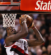 The Blazers' Greg Oden (52) eyes the basket with tongue out looking for another dunk. The Blazers beat the Heat 106-68....