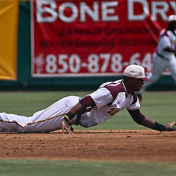 June 04, 2011; Tallahassee, FL, USA; Bethune-Cookman Wildcats short stop Brashad Johnson makes a diving attempt to stop a hit during the second inning of the Tallahassee regional of the 2011 NCAA baseball tournament against the UCF Knights at Dick Howser Stadium. Mandatory Credit: Derick E. Hingle