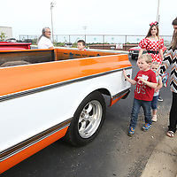"""Jace Eli Bond, 4, touches the side of a Chevy C10 pickup truck as he walks with his aunt Tracy Butler in the parking lot at TCPS for his Make-A-Wish dream on Wednesday morning. Jace, a fan of the Disney Pixar movie """"Cars"""", got a car show form the Tupelo Car Club and a scavenger hunt."""
