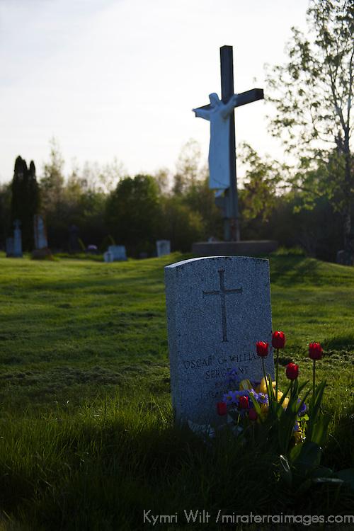 North America, Canada, Nova Scotia, Guysborough. Tombstones and flowers at the Guysborough Cemetery.