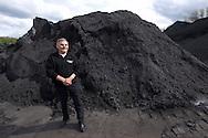 Nederland, Heerlen , 20040419.<br /> Ex mijnwerker Jan Hellebrand (68), houwer, schiethouwer en voorman, particuliere mijn Laura/Julia en Anna 1951-1988, Eygelshoven en Duitsland.<br /> heeft  37 jaar ondergronds gewerkt, zowel in Nederland als in Duitsland. Nu veel last van zijn gezondheid.<br /> Hier gefotografeerd op de bijna afgegraven steenberg van de mijn de Julia nabij de Hopel.