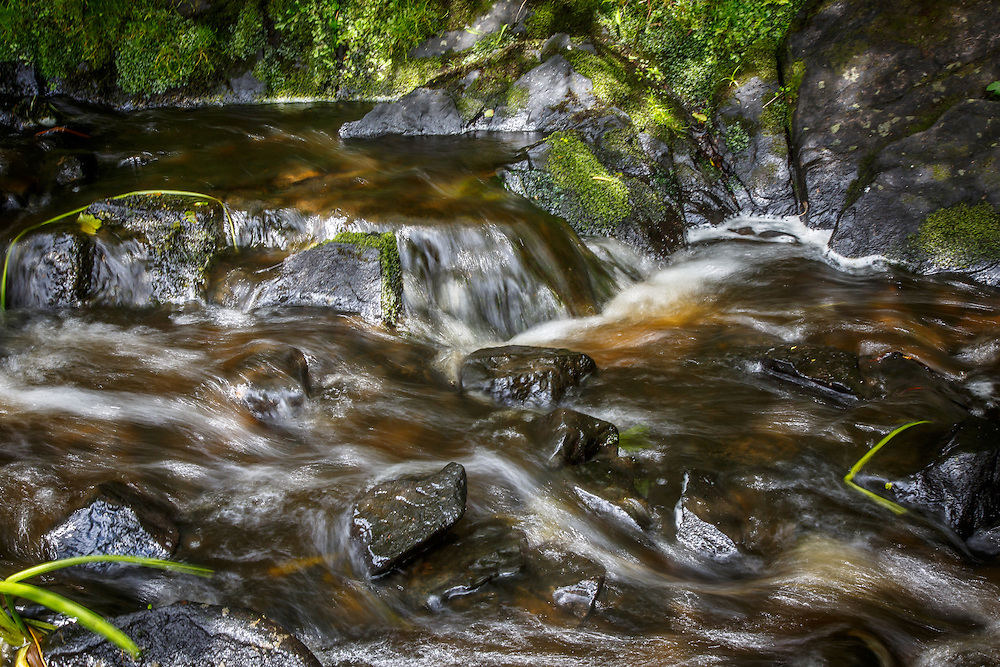 Water runs into the Kilbride Dam, the water source for Laphroaig Distillery at Port Ellen, Isle of Islay, Scotland, July 17, 2015. Gary He/DRAMBOX MEDIA LIBRARY