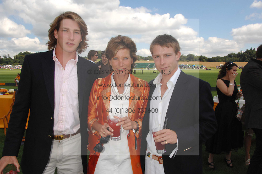 SARAH HUNT widow of racing driver James Hunt and her sons, Left FREDDIE HUNT and right TOM HUNT at the final of the Veuve Clicquot Gold Cup 2007 at Cowdray Park, West Sussex on 22nd July 2007.<br />