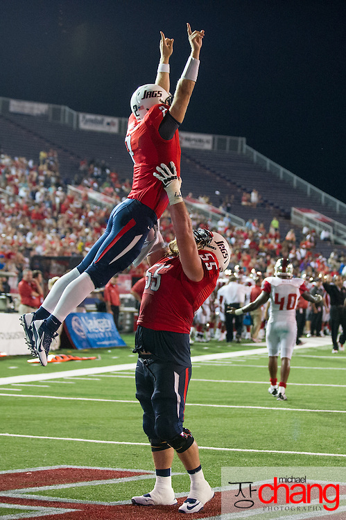 MOBILE, AL - SEPTEMBER 14: Quarterback Ross Metheny #2 celebrates with offensive linesman Chris May #55 of the South Alabama Jaguars after catching a pass for a touchdown during their game against the Western Kentucky Hilltoppers on September 14, 2013 at Ladd-Peebles Stadium in Mobile, Alabama. South Alabama defeated Western Kentucky 31-24.  (Photo by Michael Chang/Getty Images) *** Local Caption *** Ross Metheny; Chris May