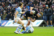 James Ritchie is tumbled by Ramiro Moyano during the Autumn Test match between Scotland and Argentina at Murrayfield, Edinburgh, Scotland on 24 November 2018.