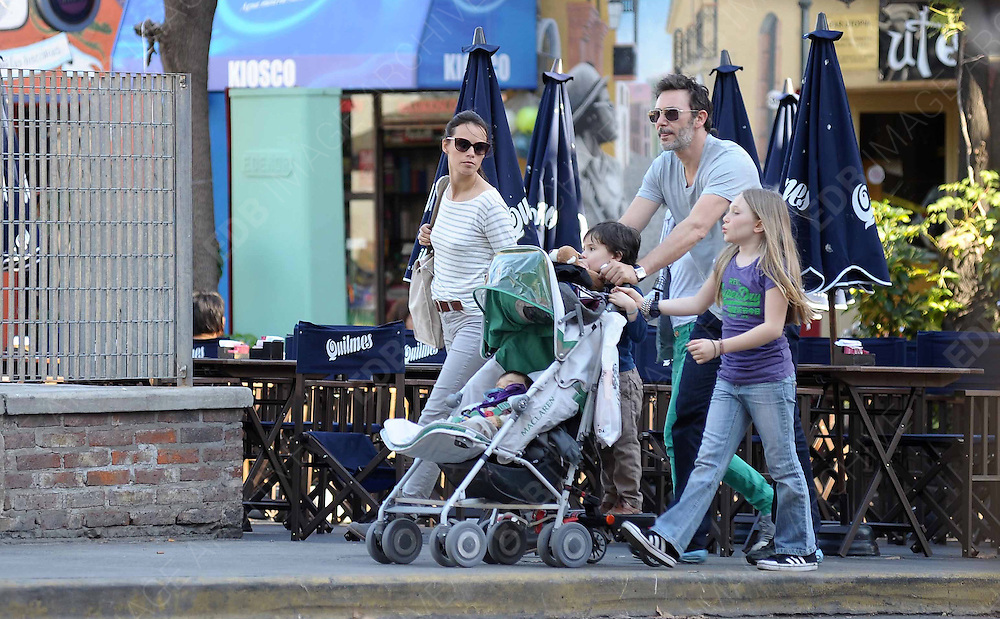 30.JUNE.2012. BUENOS AIRES<br /> <br /> MICHEL HAZANAVICIUS, BERENICE BEJO AND THEIR 4 CHILDREN WALKING IN BUENOS AIRES.<br /> <br /> BYLINE: EDBIMAGEARCHIVE.CO.UK<br /> <br /> *THIS IMAGE IS STRICTLY FOR UK NEWSPAPERS AND MAGAZINES ONLY*<br /> *FOR WORLD WIDE SALES AND WEB USE PLEASE CONTACT EDBIMAGEARCHIVE - 0208 954 5968*