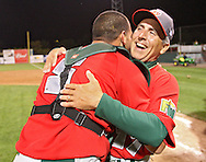 TinCaps catcher Robert Lara (5) hugs manager Doug Dascenzo (17) after their win over the Bees in game three of the Midwest League Championship at Community Field in Burlington, Iowa on September 17, 2009.