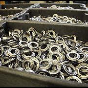 nella fotografia: pezzi e stampati metallici prodotti.. Scanferla, azienda di Avigliana (TO) specializzata nella progettazione e costruzione stampi progressivi e nello stampaggio a freddo. La produzione è di circa 50 milioni di particolari metallici all'anno, destinata principalmente al mercato dell'Automotive e dell'elettroutensile.