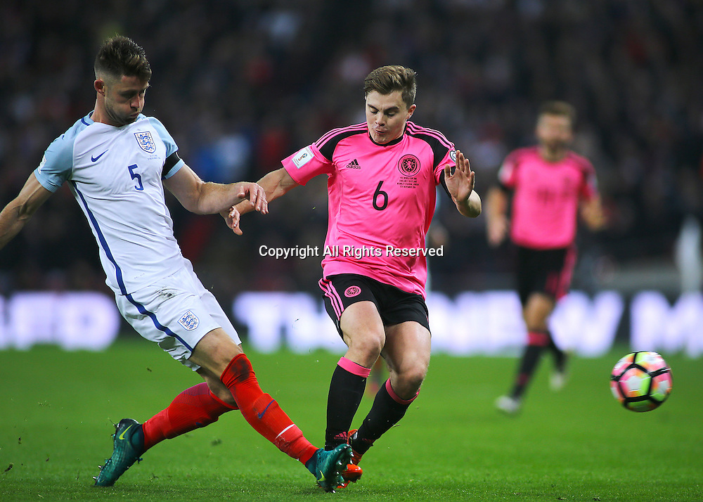 11.11.2016. Wembley Stadium, London, England. World Cup Qualifying Football. England versus Scotland. Gary Cahill of England wins a challenge against James Forrest of Scotland