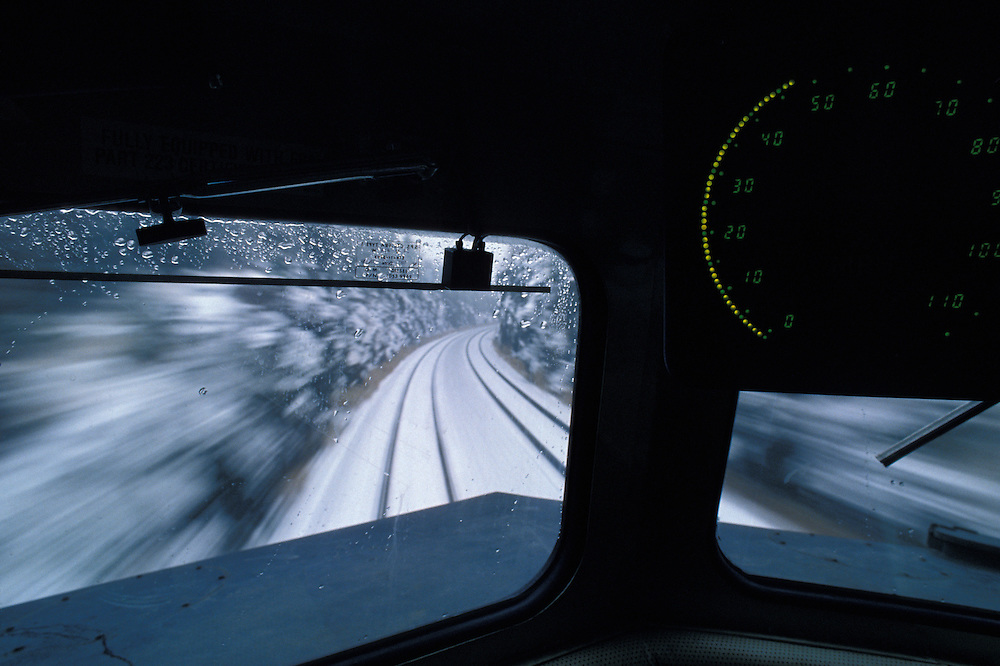 Canada, Ontario, VIA Rail passenger train travels down snowy tracks at 50 mph in eastern Ontario
