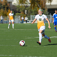 2nd year defender Cassie Longmuir (18) of the Regina Cougars in action during the women's soccer home game on October 1 at U of R Field. Credit: Arthur Ward/Arthur Images