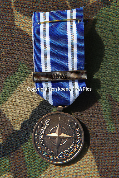 Dutch troops in Uruzgan, Afghanistan receive the NATO medal