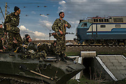 Kramatorsk, Ukraine - April 16, 2014: Ukrainian soldiers look around atop of their armored personnel carrier as villagers block them at a railway while a column of Ukrainian tanks attempts to move towards the airport as part of the operation to end pro-Russian militants uprising, in the outskirts of Kramatorsk, eastern Ukraine. CREDIT: Photo by Mauricio Lima for The New York Times