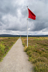 Flag indicating frontline of Government English army on  natural moorland at Culloden Moor former battlefield in Highland, Scotland