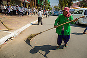 "04 FEBRUARY 2013 - PHNOM PENH, CAMBODIA: A street sweeper cleans the street in front of the National Museum before the cremation of King-Father Norodom Sihanouk in Phnom Penh. Norodom Sihanouk (31 October 1922 - 15 October 2012) was the King of Cambodia from 1941 to 1955 and again from 1993 to 2004. He was the effective ruler of Cambodia from 1953 to 1970. After his second abdication in 2004, he was given the honorific of ""The King-Father of Cambodia."" Sihanouk died in Beijing, China, where he was receiving medical care, on Oct. 15, 2012.    PHOTO BY JACK KURTZ"