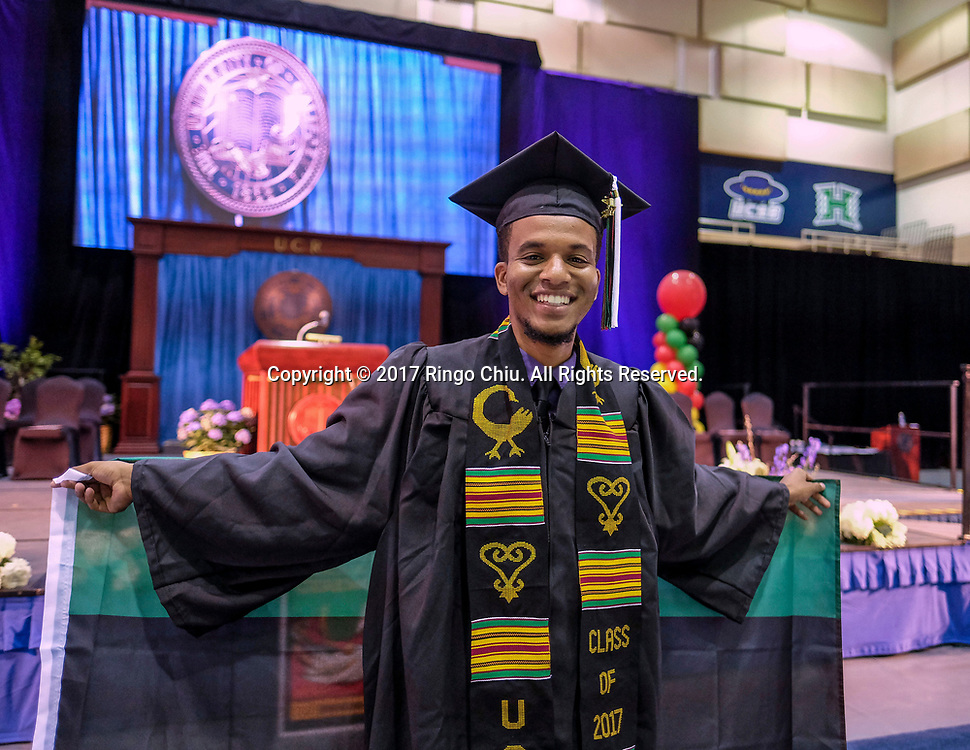 RIVERSIDE, CA - JUNE 11, 2017: Graduate Alexander Wilson poses in the Black Graduation Ceremony at University of California, Riverside, Sunday June 11, 2017. (Photo by Ringo H.W. Chiu / For The Times)(Photo by Ringo Chiu)<br /> <br /> Usage Notes: This content is intended for editorial use only. For other uses, additional clearances may be required.