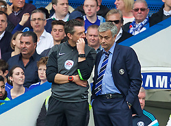 LONDON, ENGLAND - Sunday, May 3, 2015: Chelsea's manager Jose Mourinho speaks with with fourth referee Lee Probert during the Premier League match against Crystal Palace at Stamford Bridge. (Pic by David Rawcliffe/Propaganda)