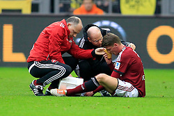 01.03.2014, Signal Iduna Park, Dortmund, GER, 1. FBL, Borussia Dortmund vs 1. FC Nuernberg, 23. Runde, im Bild Mike Frantz (1 FC Nuernberg #17) wird verletzungsbedingt am Boden behandelt // during the German Bundesliga 23th round match between Borussia Dortmund and 1. FC Nuernberg at the Signal Iduna Park in Dortmund, Germany on 2014/03/01. EXPA Pictures © 2014, PhotoCredit: EXPA/ Eibner-Pressefoto/ Schueler<br /> <br /> *****ATTENTION - OUT of GER*****